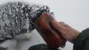 Рыбак спас примерзшего к бутылке щенка