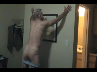 Hot daddy pleasuring himself on bed