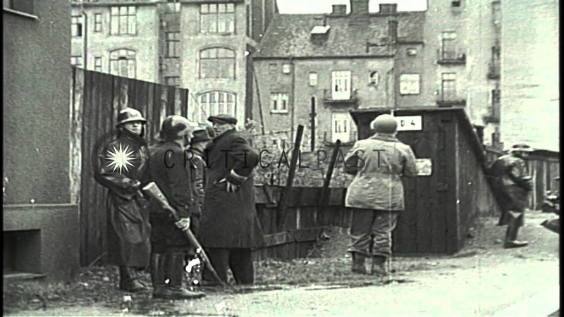Czech partisans and US soldiers round up German soldiers and civilian Stock Footage