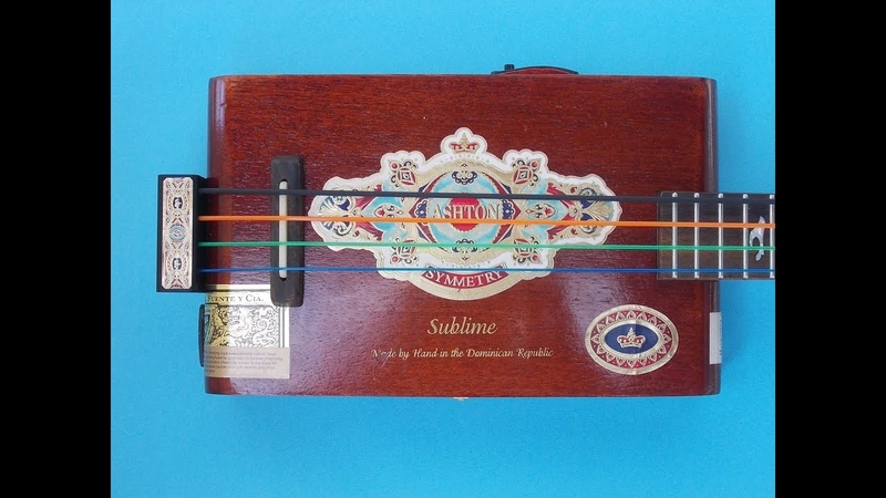 Bass guitar with nylon strings. Cigar box bass. Electric guitar scale lenght.