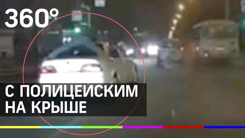 Барсеточники прокатили полицейского на крыше