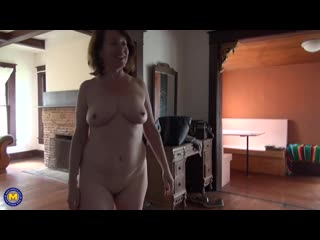 Mature lady with a pink pussy and big lips playing with her toy