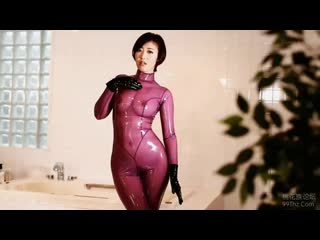 Asian girl in pink latex catsuit